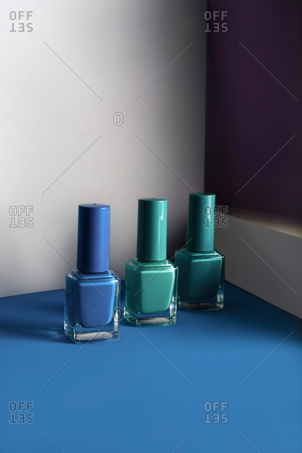 Multi-colored nail polish on pastel colors geometric pattern background