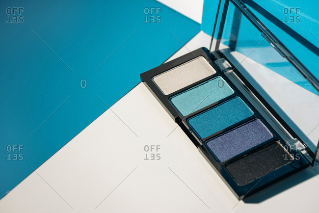 soft blue eyeshadow palette, on geometric background. Concept product make up.