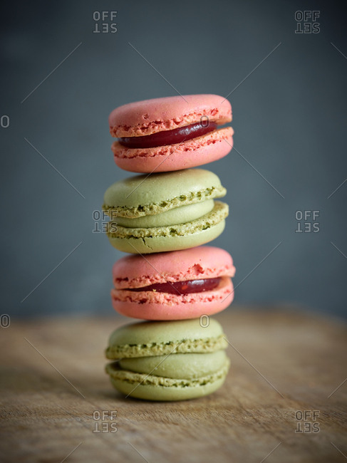 pile of bright fresh tasty macaron biscuits on wooden table