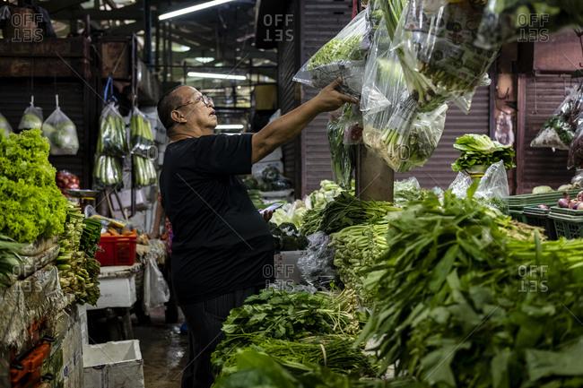 Bangkok, Thailand - September 5, 2018: Vegetable seller at Khlong Toey market