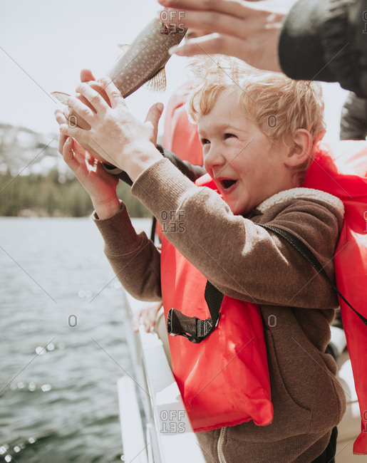 Excited boy catching fish at Mammoth Lakes, California