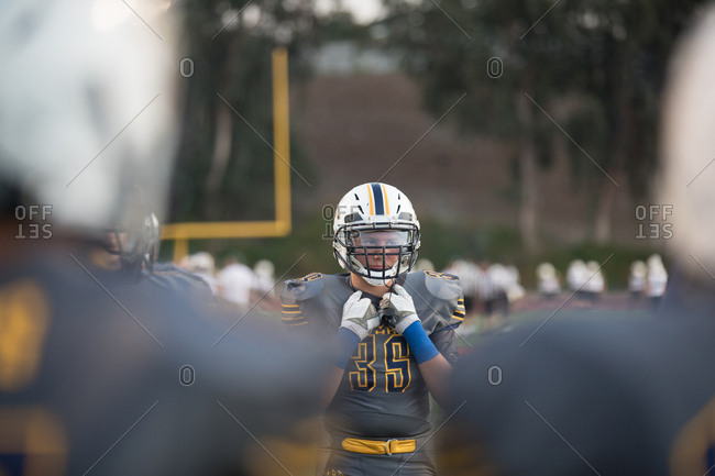 Teen boy at warm-ups before the tackle football game