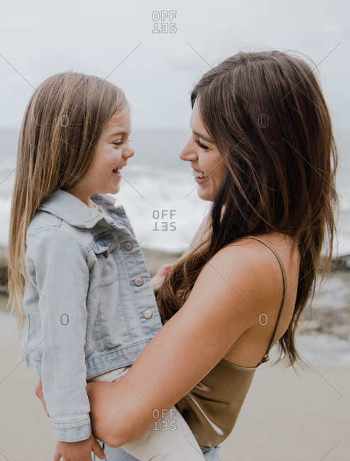 Mother and daughter smiling lovingly at one another