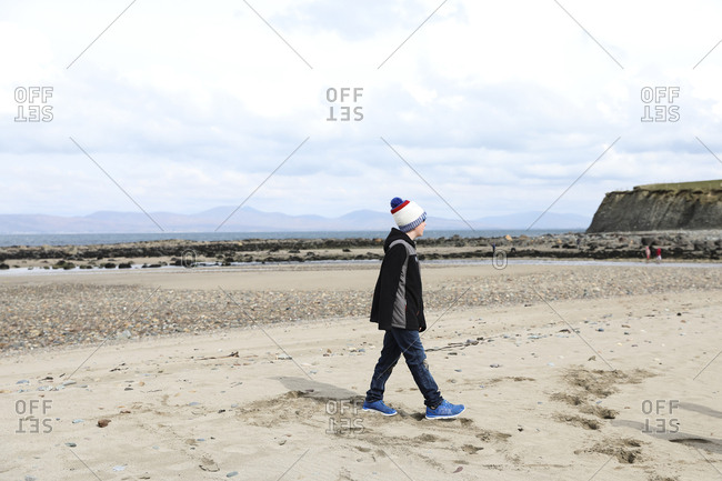 Tween Boy Walks on Rocky Irish Beach
