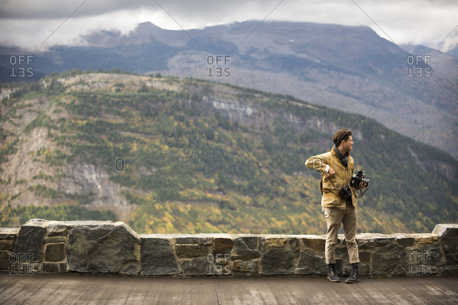 Glacier National Park, MT, USA - September 18, 2015: A man with an old camera at Glacier National Park, Montana