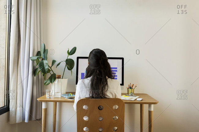 Woman Sitting In Her Home Office