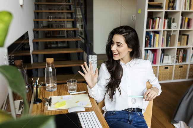 smiling young Business woman Has Video Call On home office