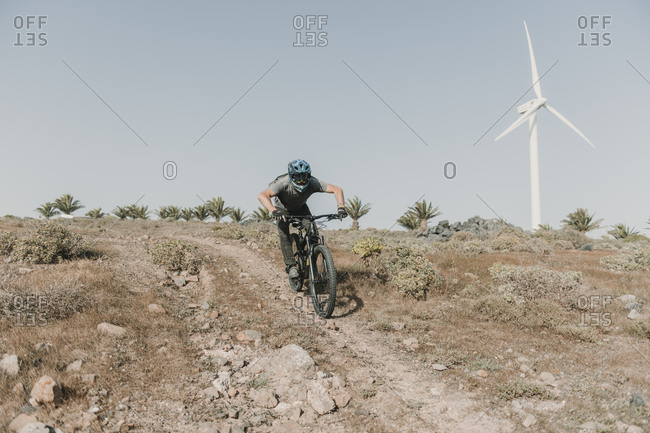 Spain- Lanzarote- mountain biker on a trip in deserted landscape
