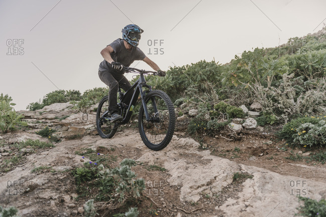 Spain- Lanzarote- mountain biker on a trail in the mountains
