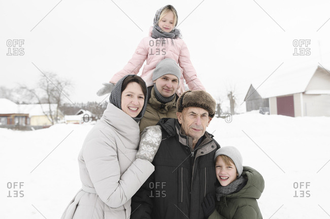 Family portrait with grandfather in winter