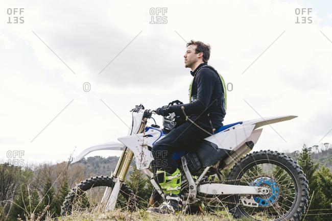 Portrait of motocross driver on circuit