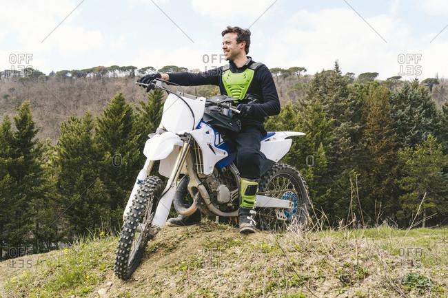 Portrait of confident motocross driver on circuit