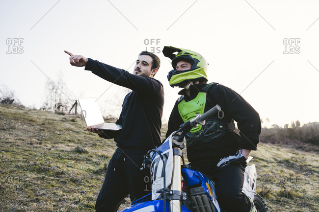 Motocross with coach pointing his finger