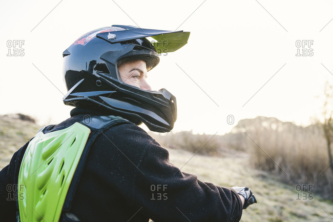 Portrait of motocross driver at sunset