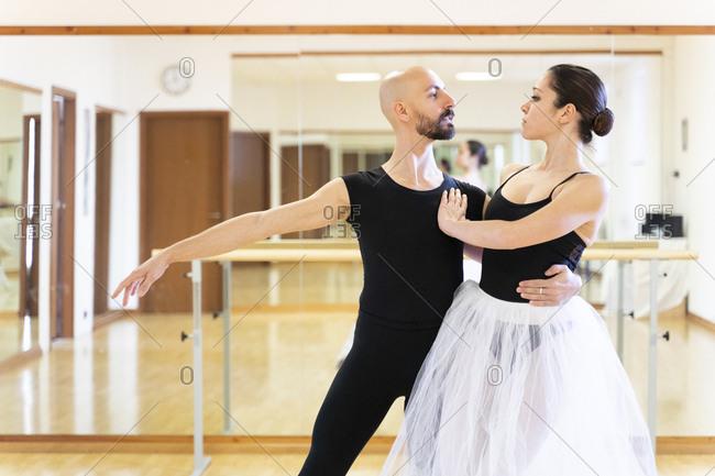 Couple dancing in ballet studio
