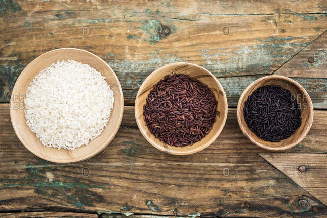 RIce- red rice- black rice in bowls- from above