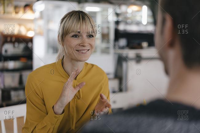 Colleagues having a break- talking