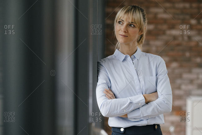 Portrait of a blond businesswoman with arms crossed