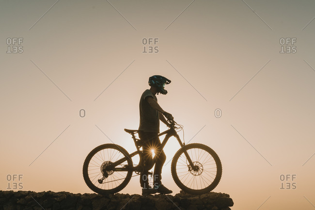 Spain- Lanzarote- mountain biker on a trip at sunset
