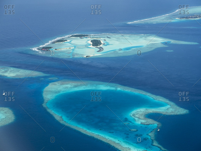 Maledives. Ross Atoll- Aerial view of island group and coral reefs