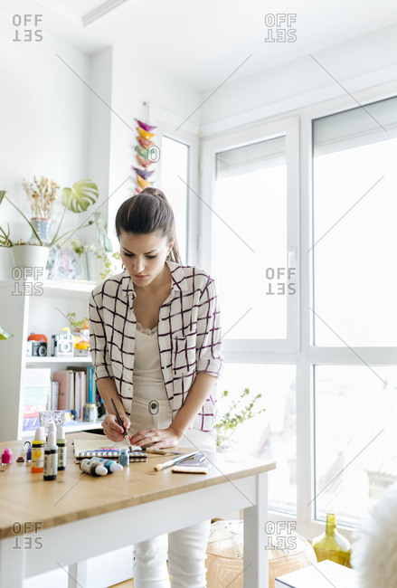 Woman painting at home