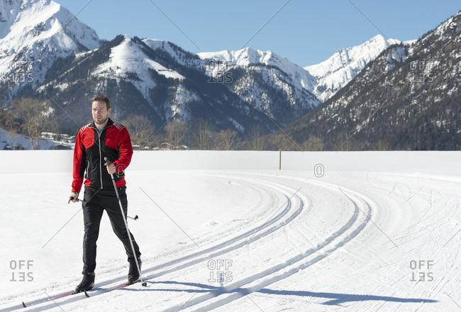 Austria- Tyrol- Achensee- man doing cross country skiing