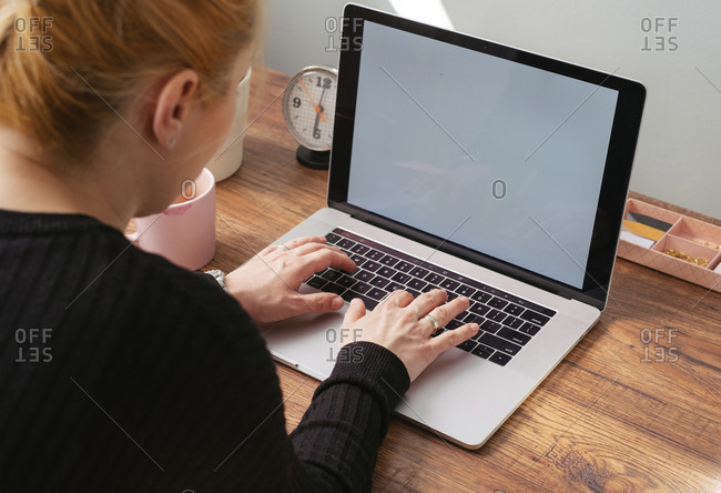 Woman working on laptop at home office