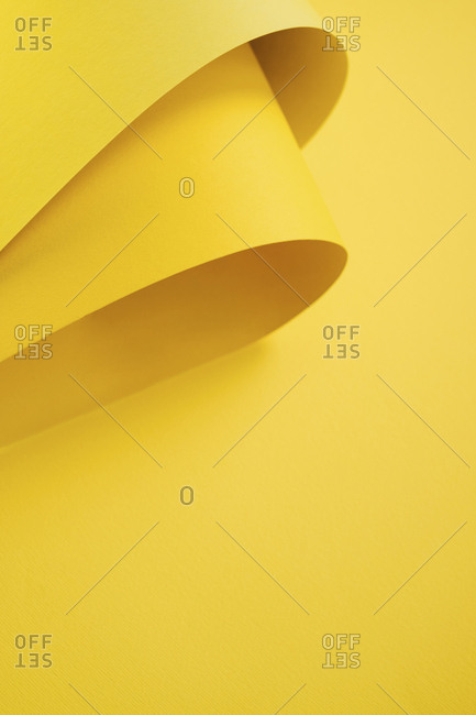 Yellow folded papers as background