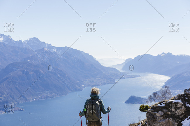 Italy- Como- Lecco- woman on a hiking trip in the mountains above Lake Como enjoying the view