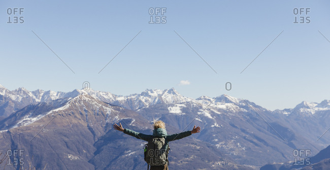 Italy- Como- woman on a hiking trip in the mountains enjoying the view