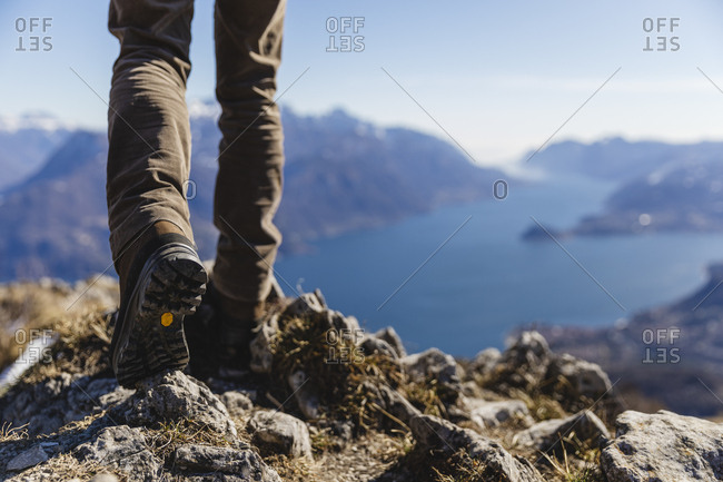 Italy- Como- detail of hiking boots on the rock