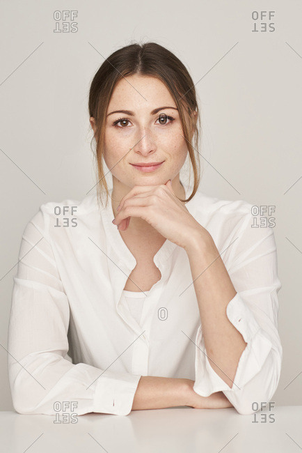 Portrait of smiling young woman wearing white blouse