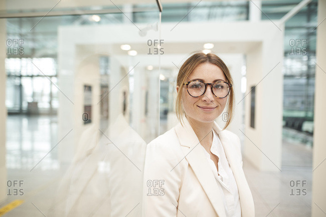 Portrait of confident young businesswoman wearing glasses