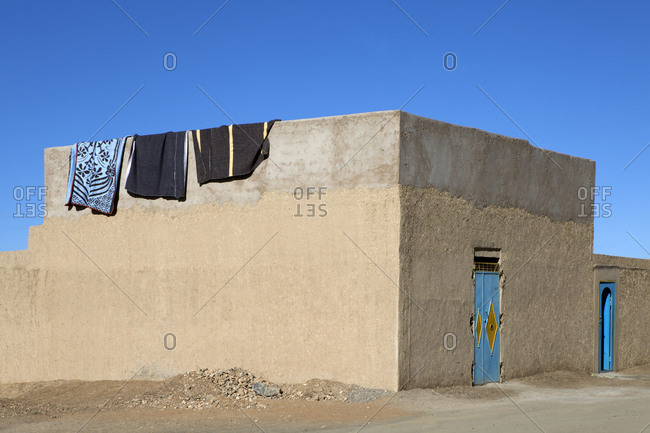 Morocco- Merzouga- Erg Chebbi- rammed earth building in oasis town Taouz