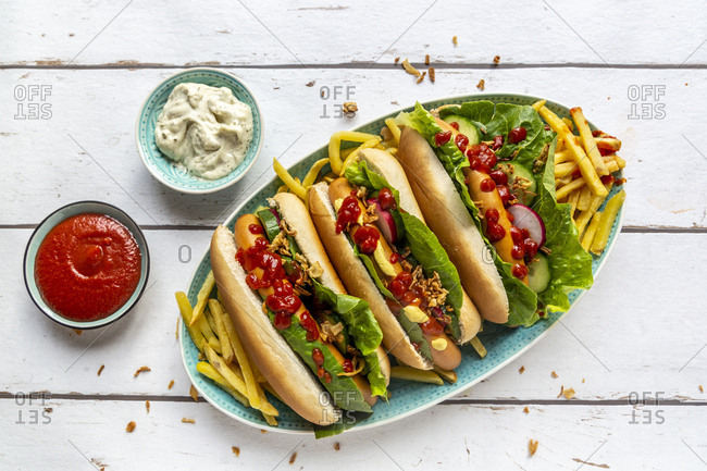 Hot dogs with french fries- ketchup and mayonnaise
