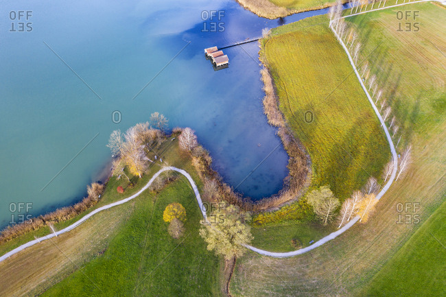 Germany- Bavaria- near Schlehdorf- bay with boathouses at Lake Kochel- aerial view