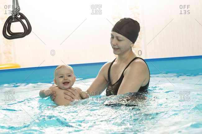 Baby swimming- mother with daughter in swimming pool