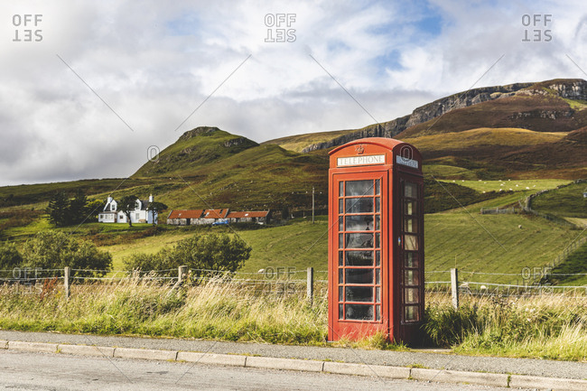 United Kingdom- Scotland- red phone booth in the countryside on the Isle of Skye
