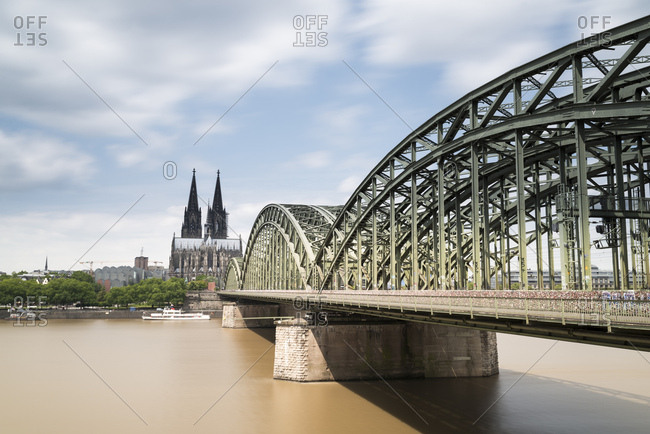 June 14, 2018: Germany- Cologne- view to Cologne Cathedral with Hohenzollern Bridge and River Rhine in the foreground