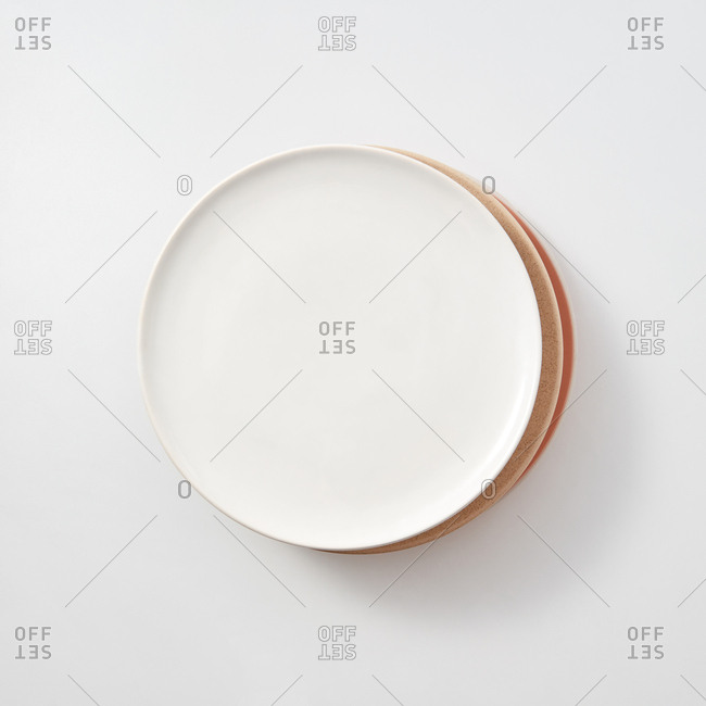 Stick from different traditional ceramic plates on a light background with copy space. Flat lay