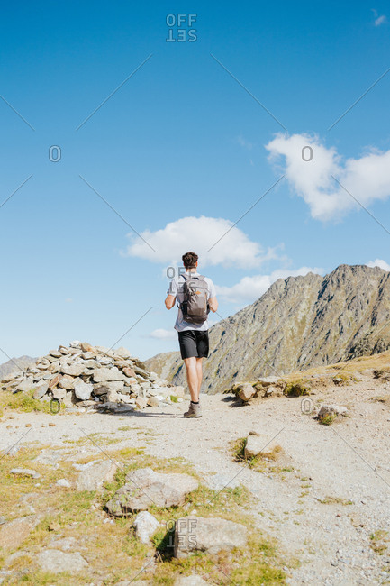 Man hiking a mountain in Andorra during summer