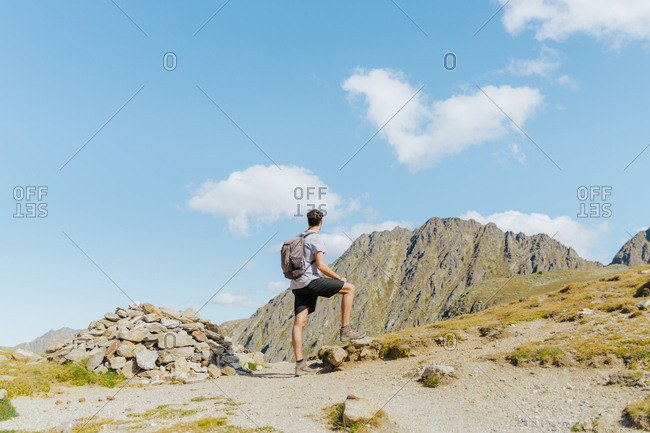Man in the mountain admiring the landscape