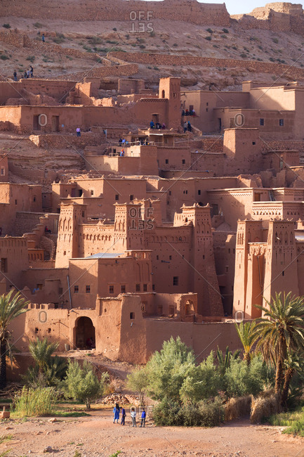 Ait Ben Haddou, Morocco - April 12, 2019: Tourists and locals walking around the kasbahs at sunset