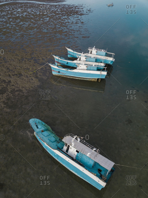 Aerial view of the boats in the ocean at low tide
