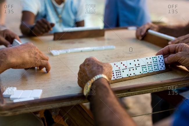 Elderly gentlemen playing a game of dominoes in Trinidad, Cuba. 2017.