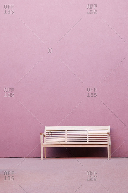 Bench in Front of Pink Wall
