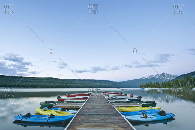 May 10, 2019: Canoes Docked on a Lake, Idaho, USA