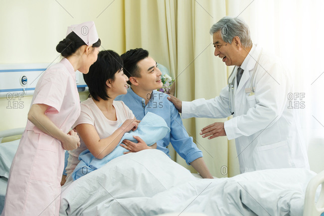 Medical staff and the parents of the newborn
