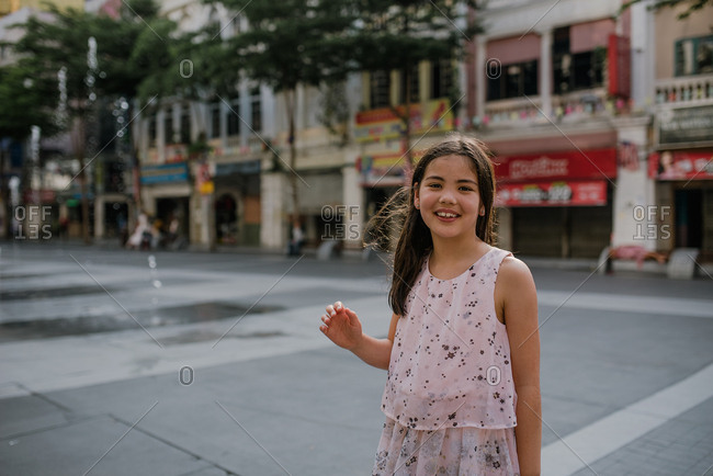 Young girl posting for the camera while exploring an open air market in Malaysia