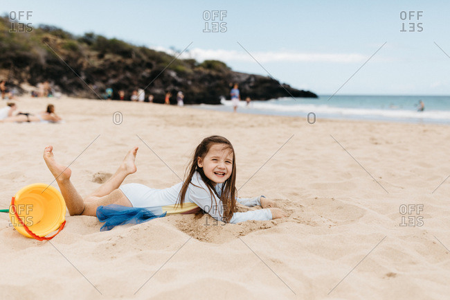 Little girl playing in the sand in Hawaii